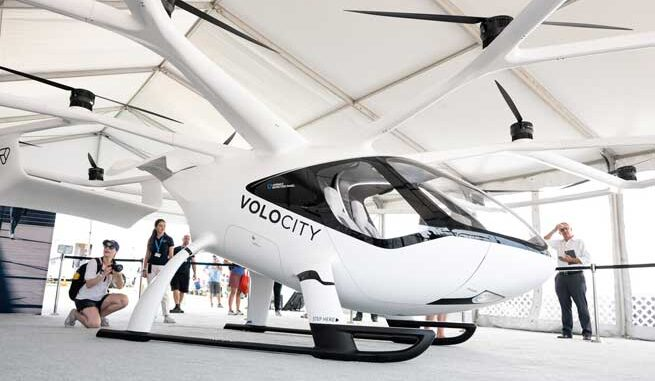 VoloCity mockup at the EAA AirVenture 2021 in Oshkosh. Visitors taking pictures of the VoloCity mockup